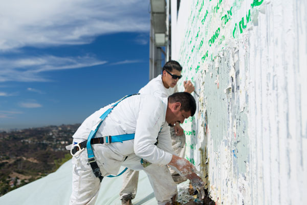 Hand and tool work The Hollywood Sign Gets a Facelift