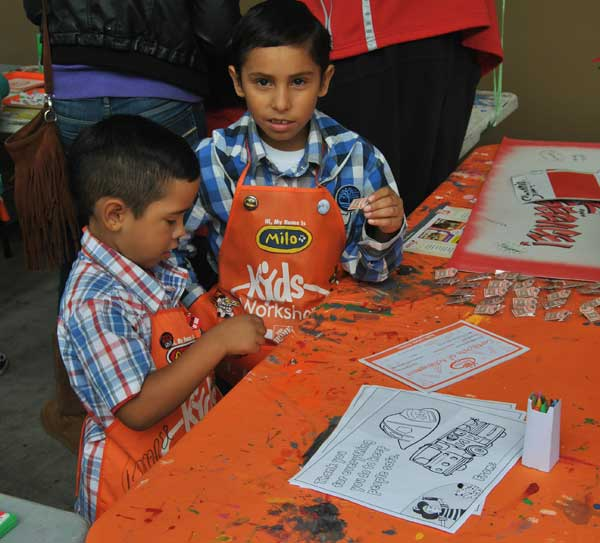 kids painting Santa Arrives at The Home Depot with Kidde Smoke Alarms