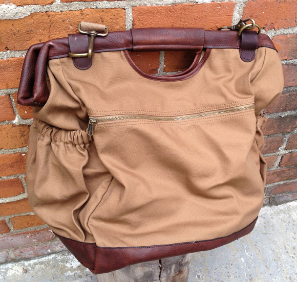 postman back Honor the Pony Express with The Postmaster Tote from Duluth Trading Company