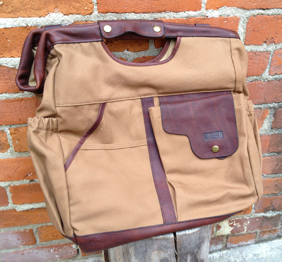 postman side Honor the Pony Express with The Postmaster Tote from Duluth Trading Company