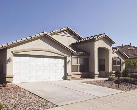 spanish style garage before Door to Door: The Most Bang For Your Buck Is A Garage Door Upgrade