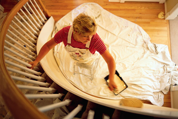 woman painting staircase Painting 101: Preparing Your Space to Paint