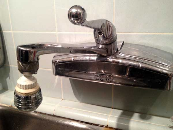 fix a dripping kitchen faucet
