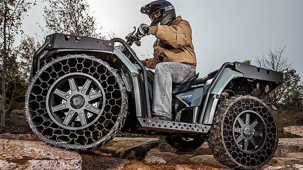 polaris sportsman wv850 h o with terrain armor non pneumatic tires featured