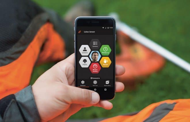 Husqvarna Fleet Services operator in the field with the new smartphone app