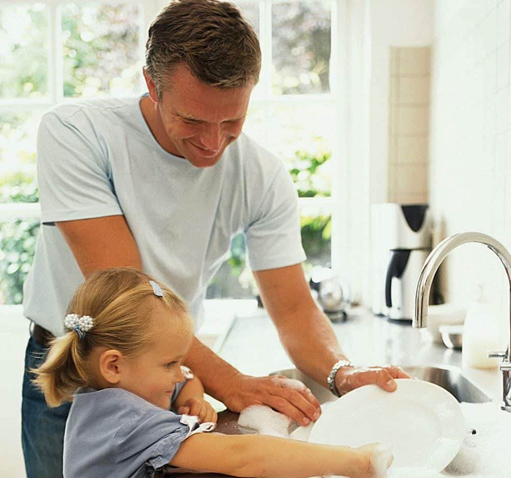 father daughter washing dishes photo asset