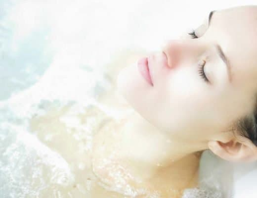 Beautiful woman dreaming in the spa.
