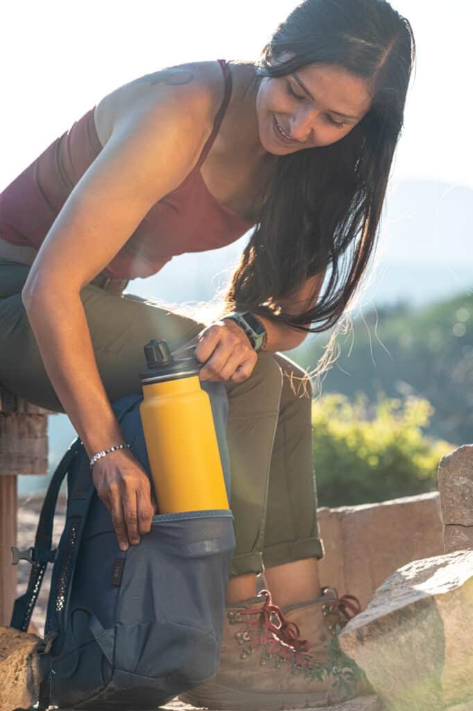 K32TKWCG MG T CHUG HOLZ Taking Bottle Out of Backpack Pocket 2 1